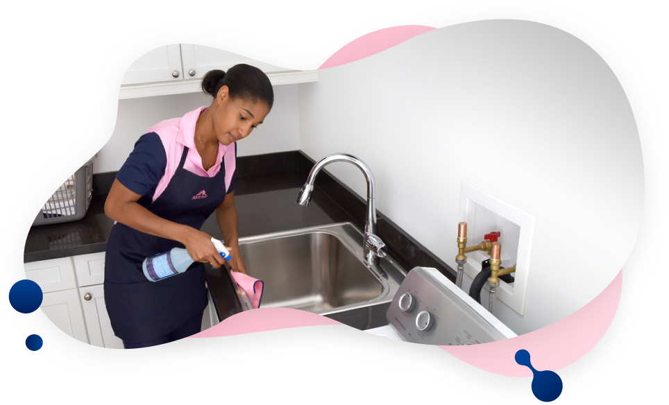 MOLLY MAID cleaner wiping sink